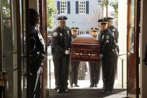 Police bring the mayor's casket into City Hall, where he lain in state on Friday. Click here for more images.