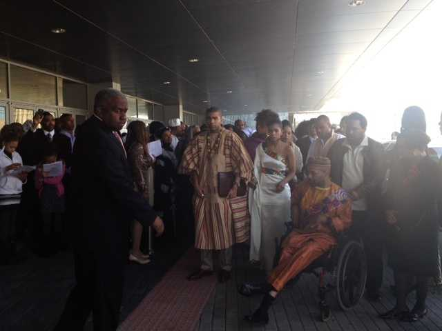 The Lumumba family enters the service.