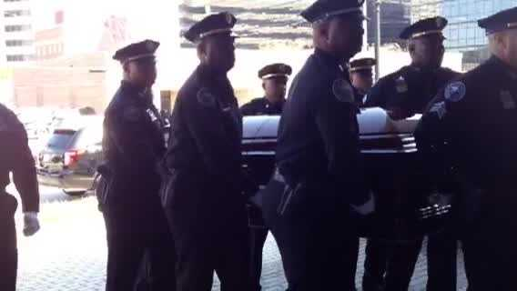 Police carry Mayor Chokwe Lumumba's casket into the Jackson Convention Complex for a funeral service.