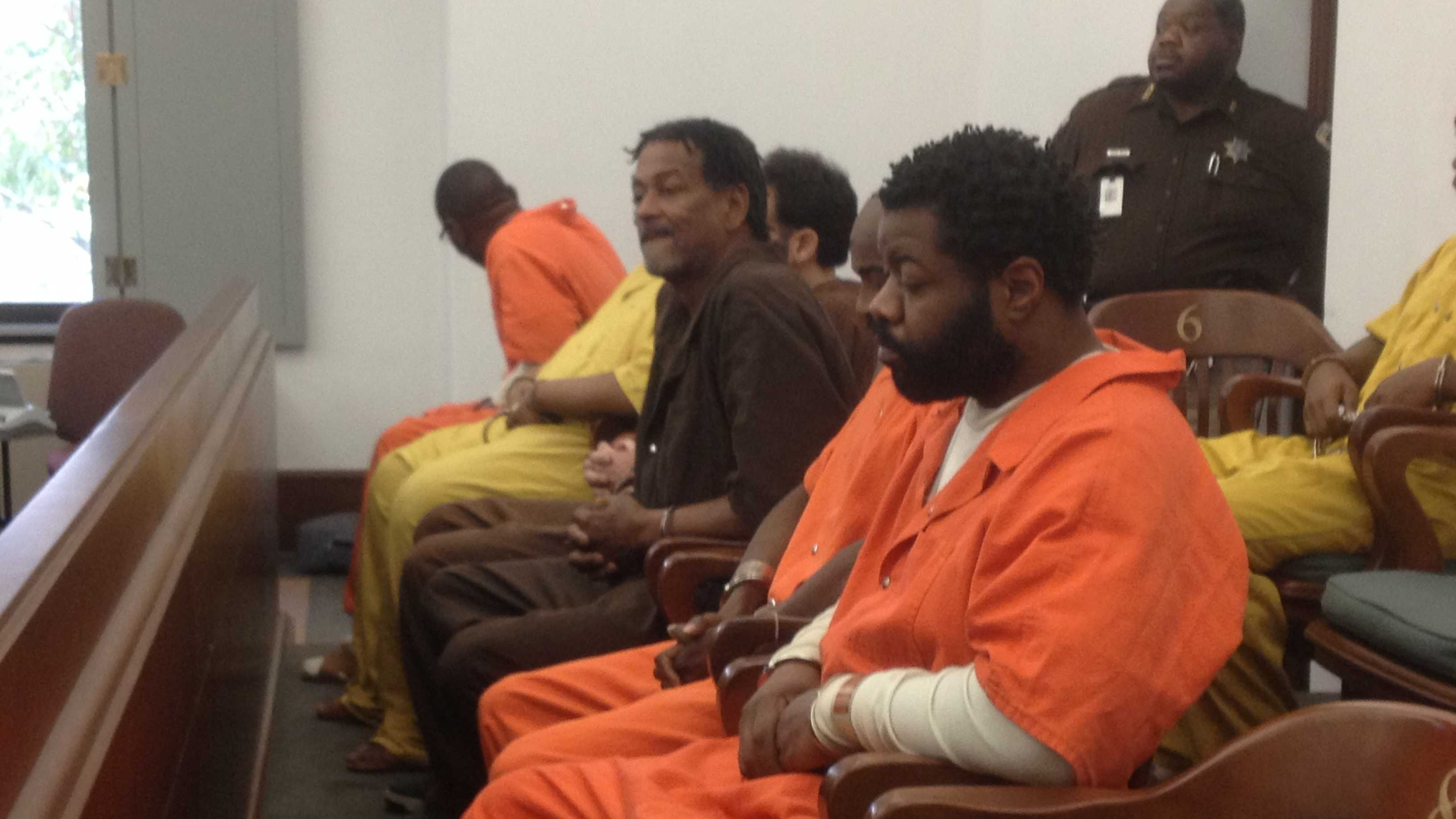 Percy Barber, forefront wearing orange, is charged with murder in the February beating death of Willie Burton.
