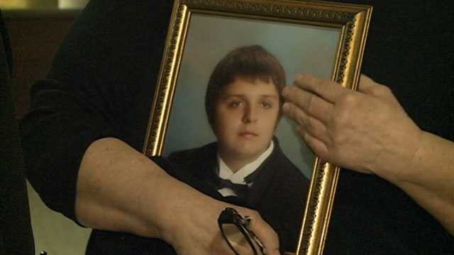 Josh Hardin's grandmother holds a picture of him.