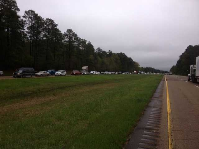 Traffic was backed up Monday along Highway 49 South between D'Lo and Braxton after high water forced transportation officials to close the road.