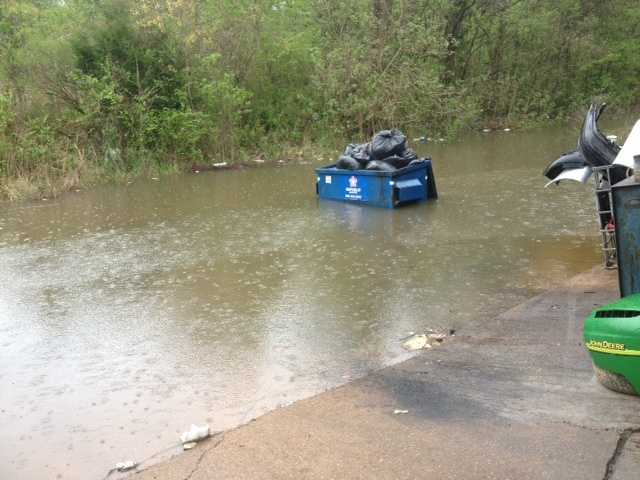 Behind P&J Auto repair, water from Town Creek was rising Tuesday.