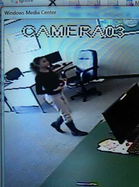 The woman in the photo is accused of cashing fraudulent checks totalling $17,605.50 at Thrifty Check Advance.