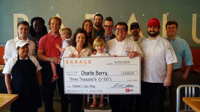 Chef David Ferris (pictured to the right of Charlie) along with the Babalu staff and Charlie and his family gathered for the check presentation.