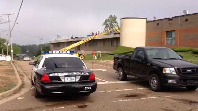 Crews work to repair Brandon Middle School after storms damaged the roof.
