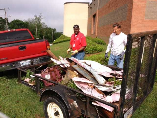 Crews work to clean up storm damage in Brandon on Tuesday, the day after a tornado outbreak in Mississippi.