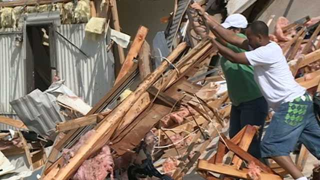 Pearl residents clean up the day after a tornado destroyed more than a dozen homes.