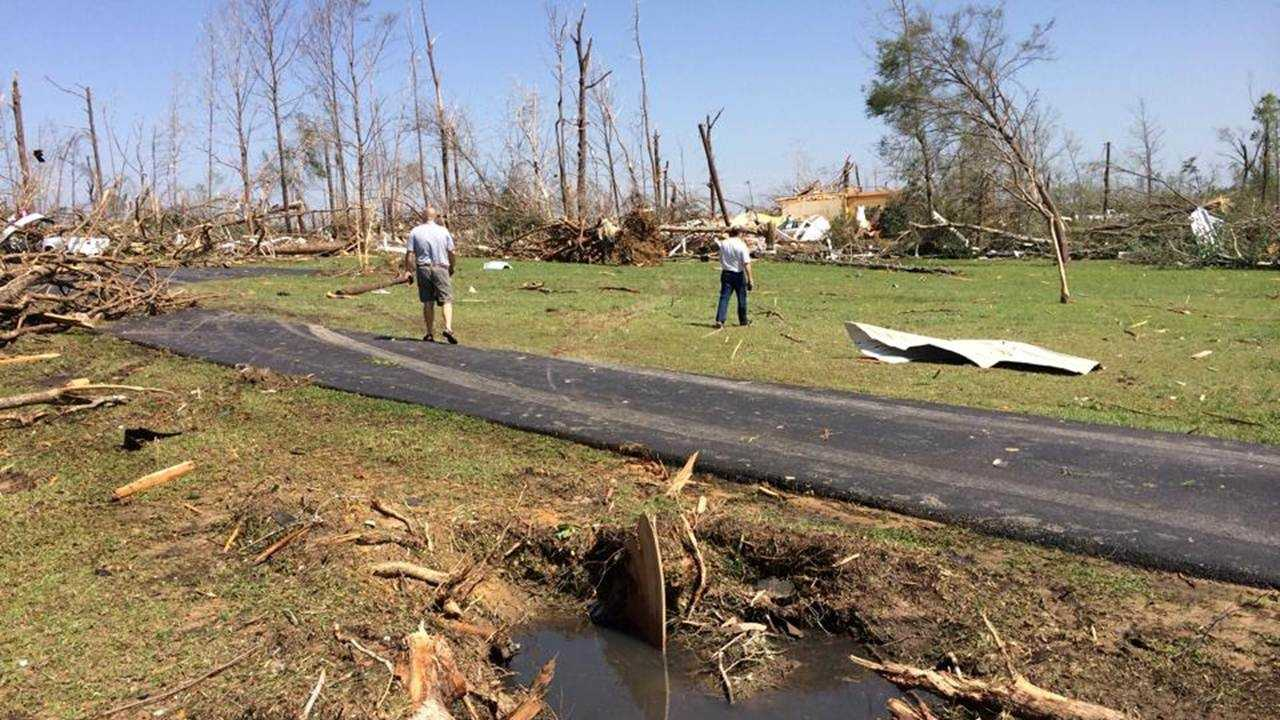 The National Weather Service surveys tornado damage Tuesday in Louisville.