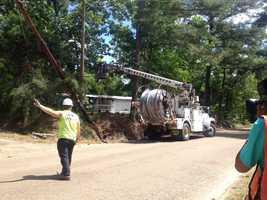 Crews work to repair storm damage in Warren County.