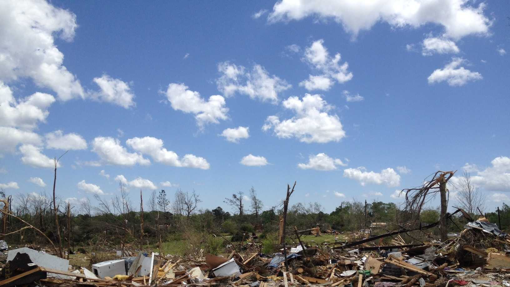 Debris is all that is left of the family's home in Winston County.