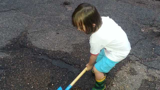 Jason Hulsman's 4-year-old son is sick of the pothole on his street.