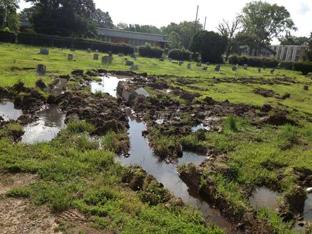 City officials say crews damaged some of the headstones while coming to prepare for a burial.
