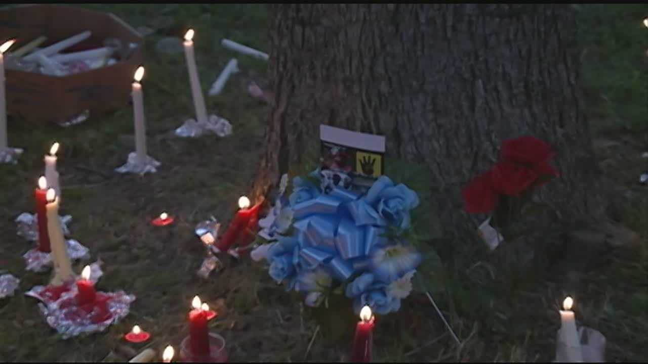 Friends and family held a candle light vigil for the 19 year-old shot and killed in a Jackson park this week.