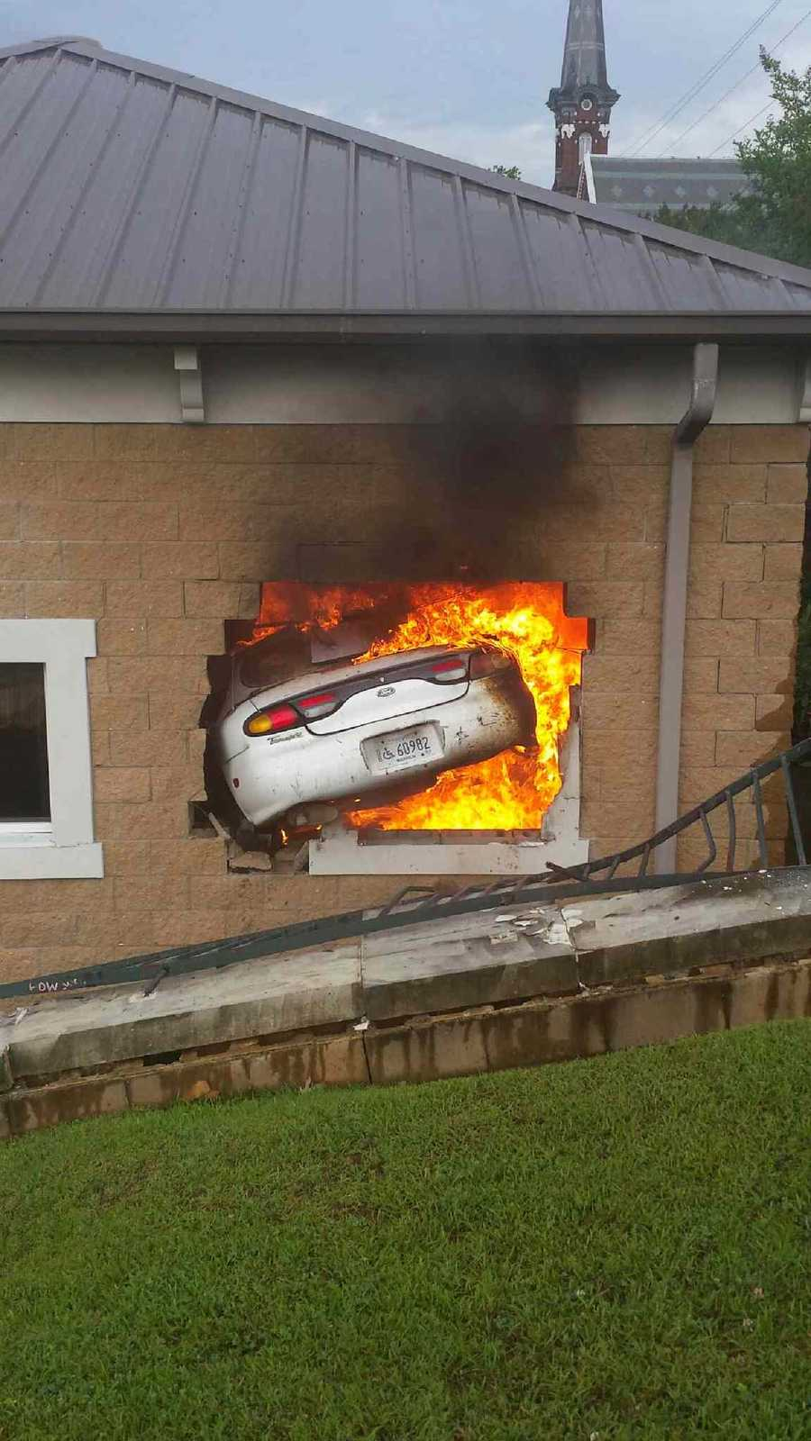 A Vicksburg man was killed when his car knocked a hole in the back of Vicksburg Police Department and caught fire.