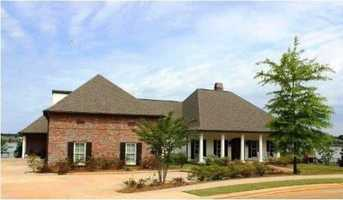 109 rosedowne Bnd, Madison, MS 39110Spend time cooling off in your own in-ground pool while you take in the lake views! This beautiful custom built waterfront home includes five bedrooms, eight bathrooms, and over 5,900 sq ft of living space. The home is featured on realtor.com.