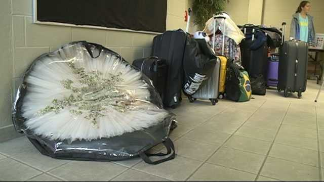 A tutu is bagged up and carried to Jackson for the International Ballet Competition.