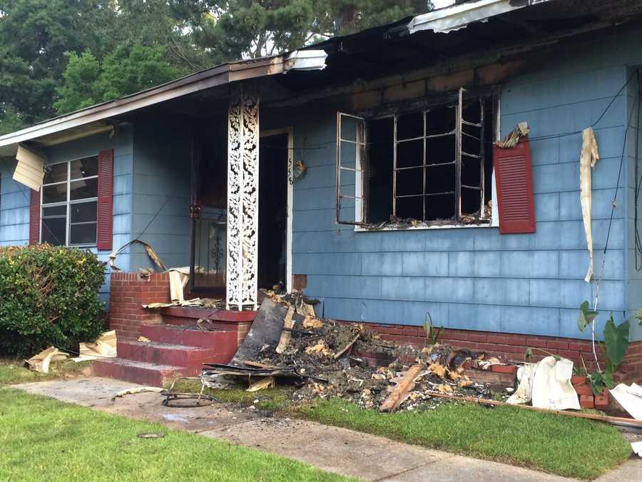 Neighbors say the same house caught fire three weeks ago.