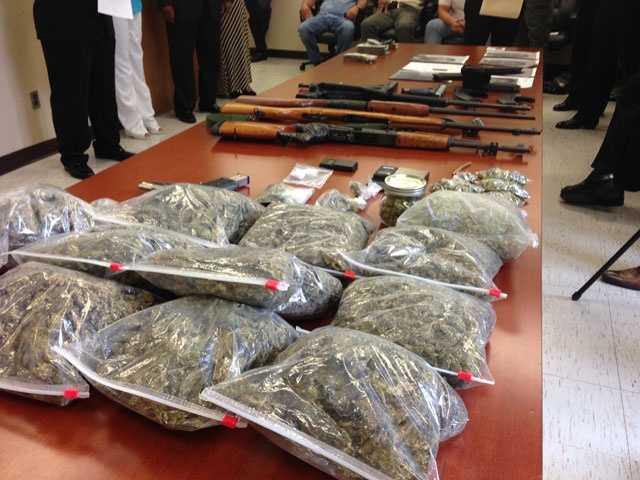 The joint operation resulted in the recovery of stolen guns, cash and drugs, authorities said.