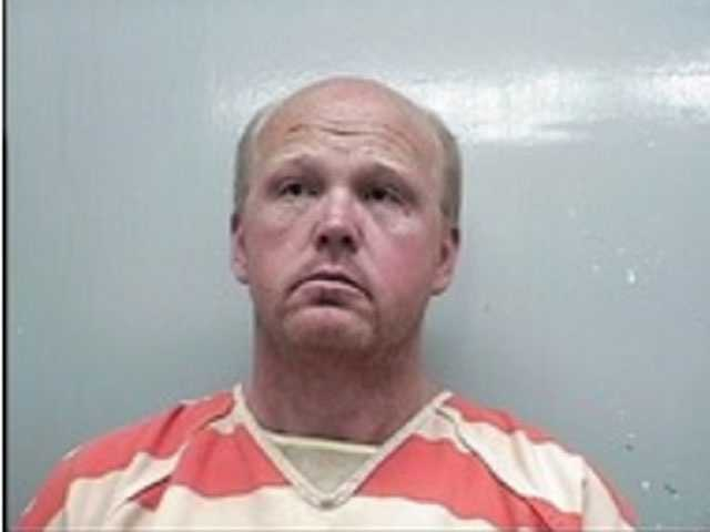 Charles Kevin Nations, 48, is charged with embezzlement of property held in trust, the Adams County Sheriff's Department says.
