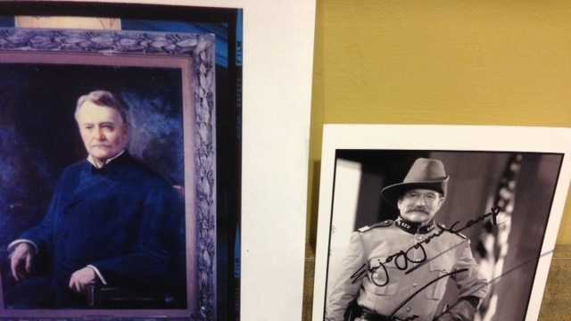 Former Mississippi Gov. Anselm J. McLaurin's portrait next to an autographed photo of his great-great-grandson, Robin Williams, at the Department of Archives.