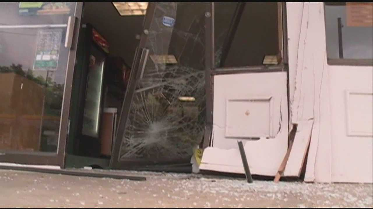 A car flies across a busy Jackson roadway and rams into a business.