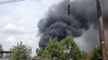Smoke could be seen for miles Tuesday when a fire breaks out at an auto salvage yard.