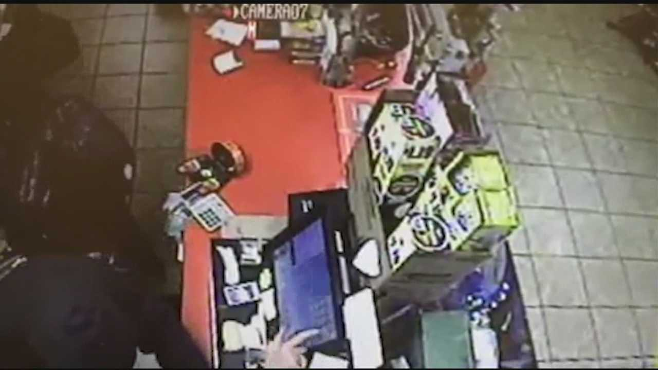 Surveillance video of a violent armed robbery is linked to more than half a dozen others.