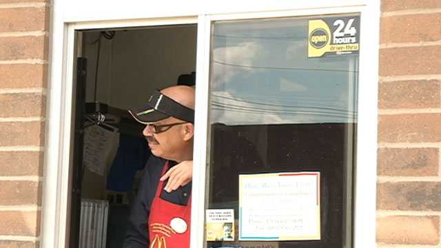 Tom Joyner donned an apron and manned the drive-thru, something he said he had never done before.