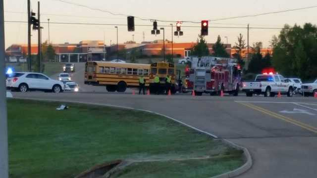 Students were loaded into a second bus and taken to school after a crash involving a bus and a pickup truck.