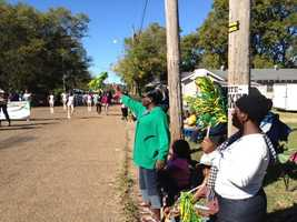Jim Hill High School and fans celebrate homecoming with a parade.