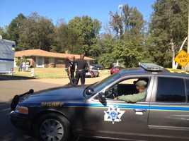 A man barricades himself inside a house in the Presidential Hills neighborhood following a shooting.