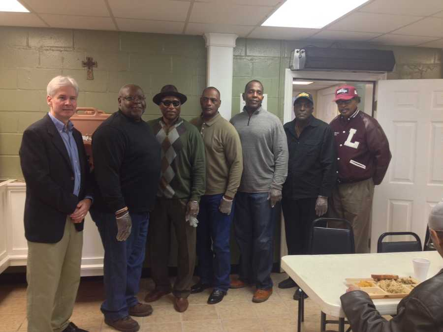 Eight retired NFL players serve Thanksgiving meals to Jackson's homeless at the Gateway Rescue Mission.