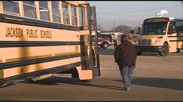 The SUV first hit a school bus on Woodrow Wilson at N. West Street.