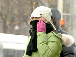 Wear at least three layers of clothing, even indoors. Layering clothes conserves more body heat than one thick garment.