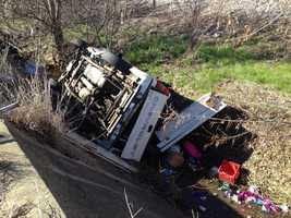 A mother and three children suffer minor injuries when a the truck they were in crashed into a ravine.