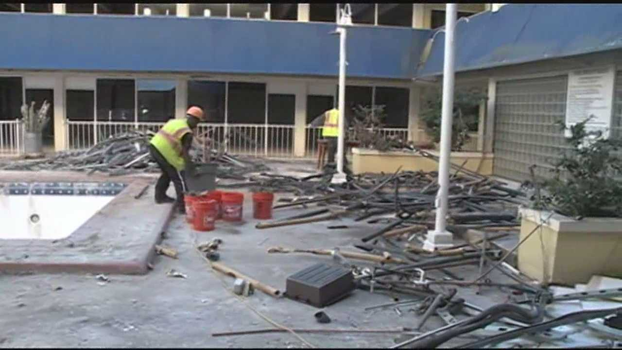 Crews prepare the Edison Walthall Hotel for renovations.