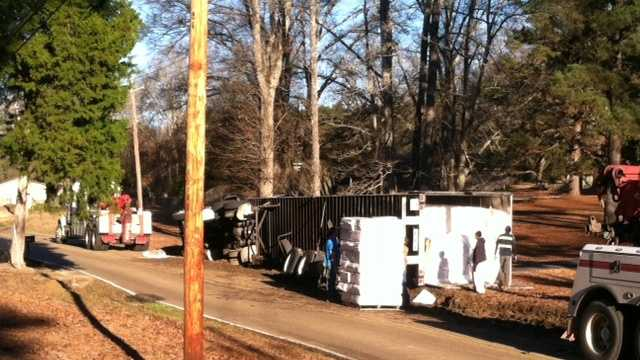 An overturned 18-wheeler shuts down traffic on Main Street in Florence.