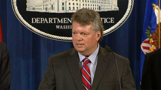 Mississippi Attorney General Jim Hood speaks during a news conference in Washington with leaders from the Justice Department.