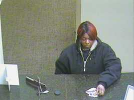 Pearl police release surveillance photos of a woman wanted in connection with a bad check case.