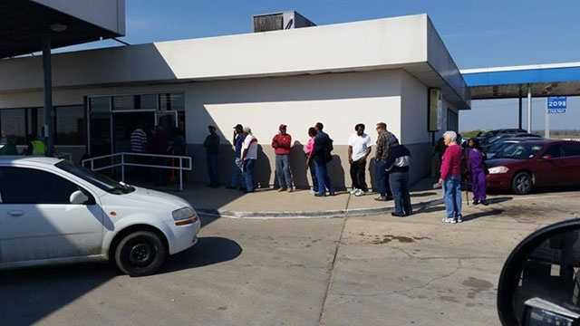 The line went out the door at a store near the Delta, Louisiana, exit.