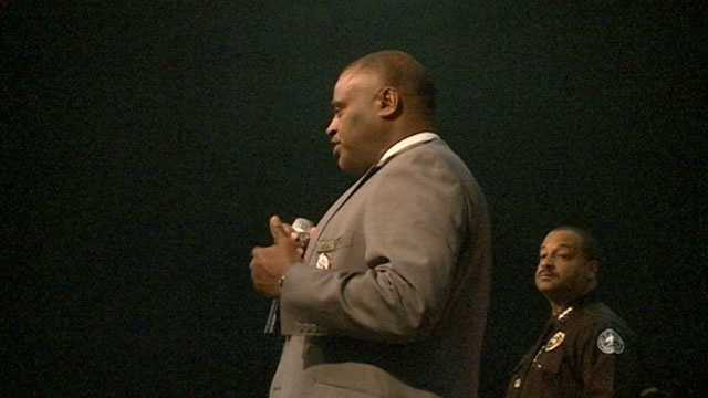 Hinds County Sheriff Tyrone Lewis and Jackson Police Chief Lee Vance speak to young men during the Save Our Sons event.