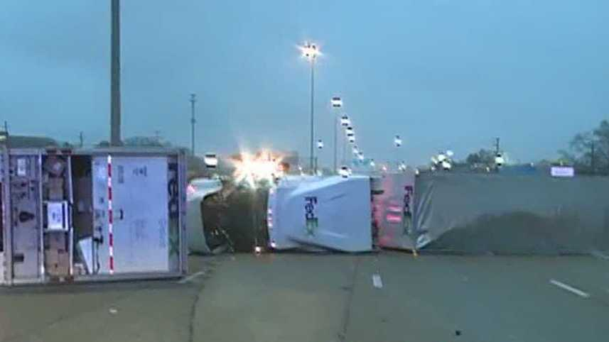 A FedEx truck overturned on Interstate 55, blocking the southbound lanes at Northside Drive.