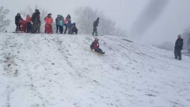There was enough snow in Belzoni for kids to pull out their sleds.