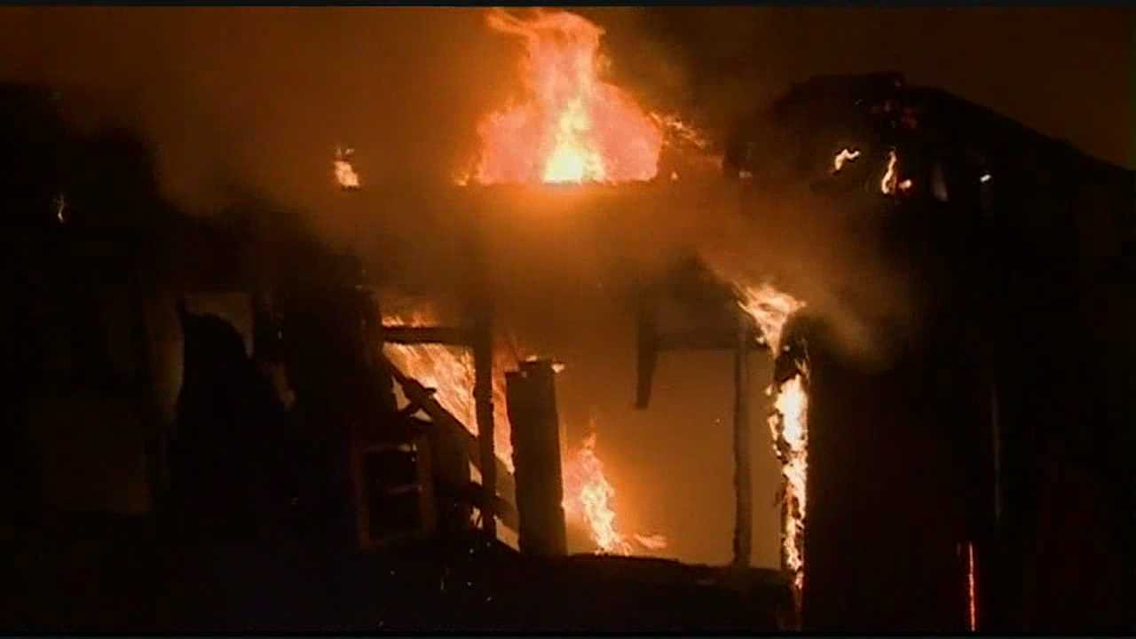 Firefighters fight an abandoned house fire in Jackson.
