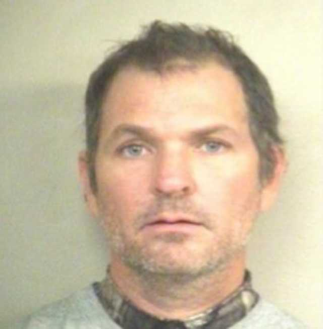Raymond Trainor, 40, is charged with two counts of business burglary, Jackson police say.