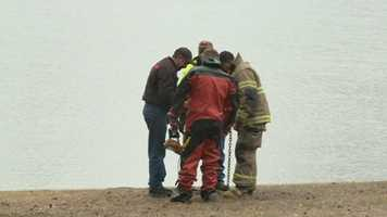 Members of the dive team prepared to go into the water to confirm that no one else was in the car.