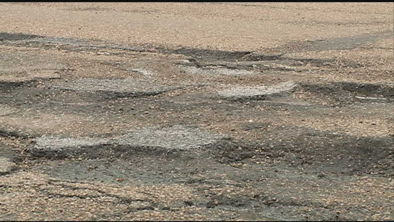 A path of potholes covers a Jackson street.