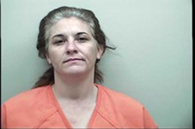 Lisa Leverette Freeman, 38, is charged with false pretense, burglary of a church and forgery, the Adams County Sheriff's Office says.