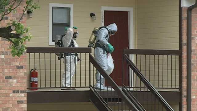 Agents donned hasmat suits to collect evidence from an apartment at the Red Apple Inn.